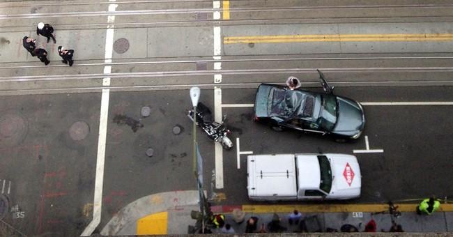 Window washer falls onto car in San Francisco