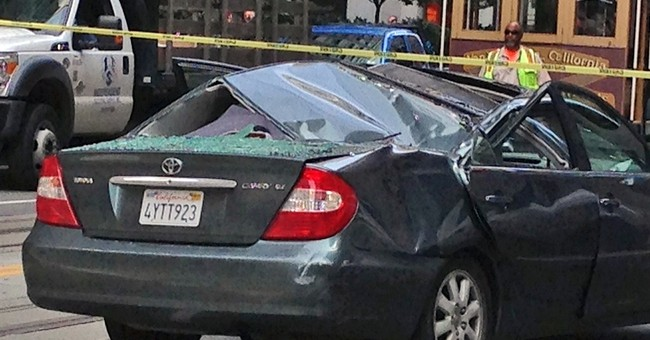 San Francisco window washer falls onto moving car