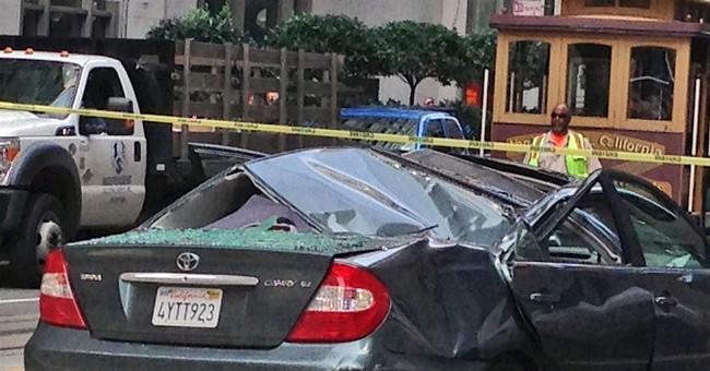 San Francisco window washer falls onto moving car
