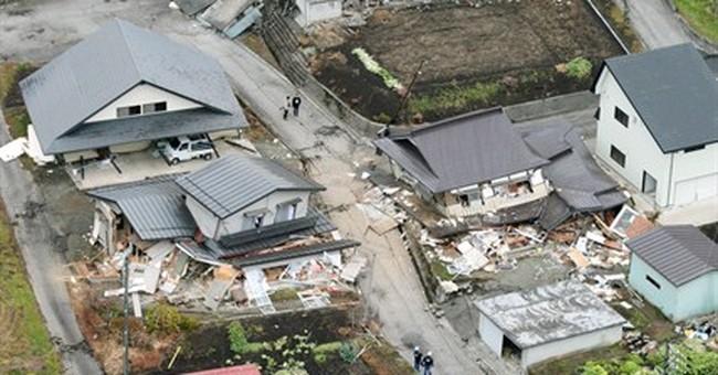 Dozens take refuge from Japan quake aftershocks