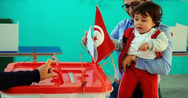Tunisia polls give ex-regime figure the edge