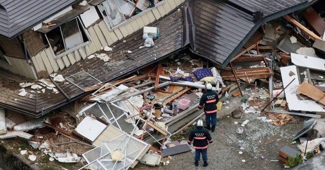 Dozens take refuge from Japan quake aftershocks