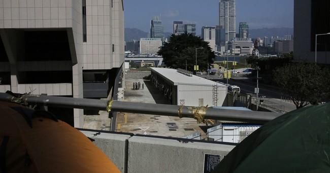 British banker can plea in HK murder case: Judge