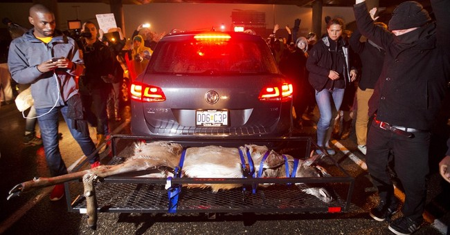 No charges in Ferguson case; chaos fills streets