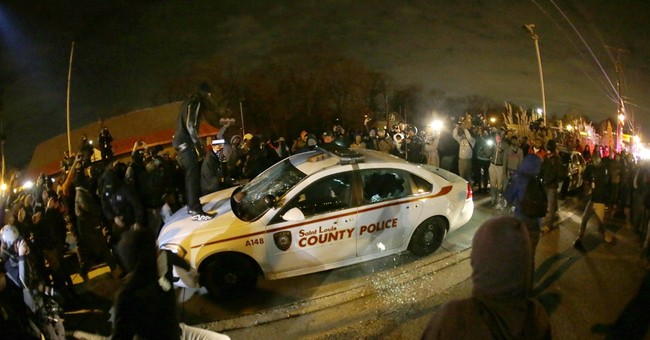 Violence in Ferguson after no indictment announced