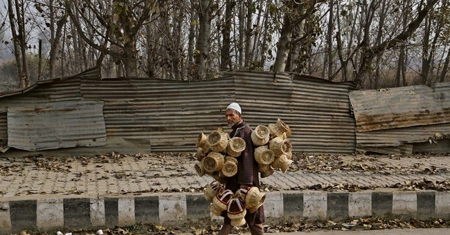 Image of Asia: Selling fire pots in the Himalayas