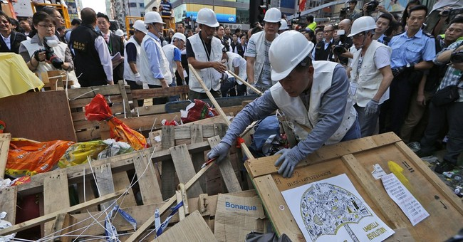 Hong Kong clears part of unruly protest site