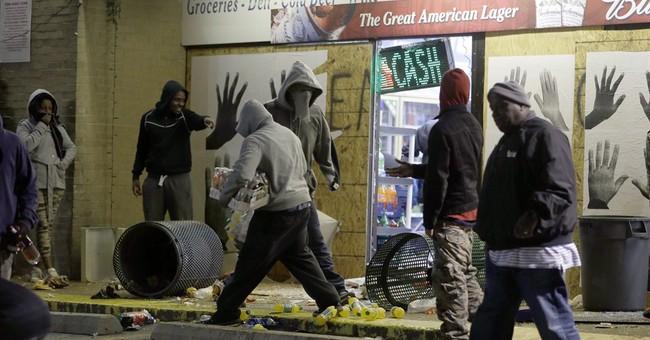 Fires burn in Ferguson, gunshots heard in streets