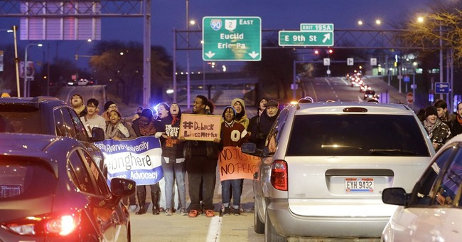 Cleveland crowd protests over boy shot by police