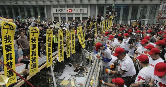 Hong Kong police arrest protesters, 7 officers