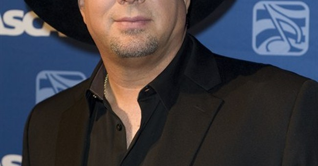Garth Brooks cites Ferguson for cancellation