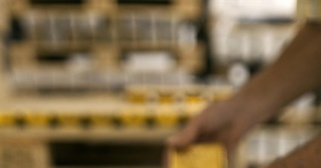 Swiss reject plan to hoard gold, limit immigration
