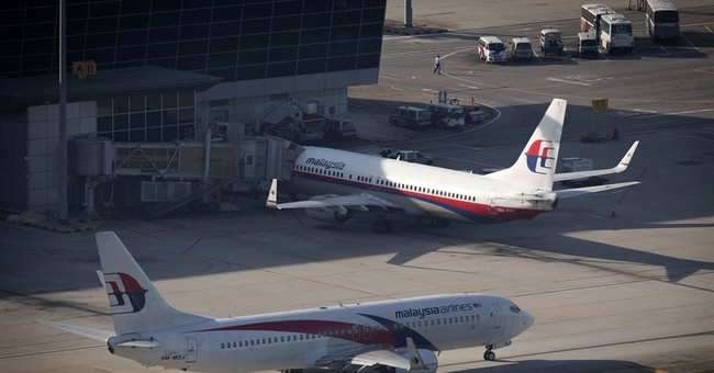 Malaysia Airlines apologizes for tweet, posts loss
