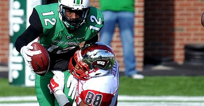 Western Kentucky beats No. 19 Marshall 67-66 in OT