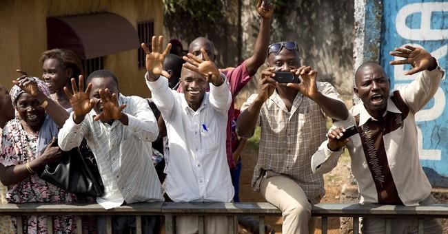 French president cheered in Ebola-stricken Guinea