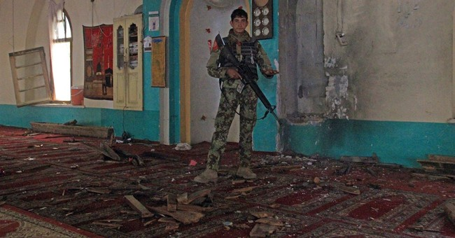 Taliban raid on guesthouse kills 2 in Afghanistan