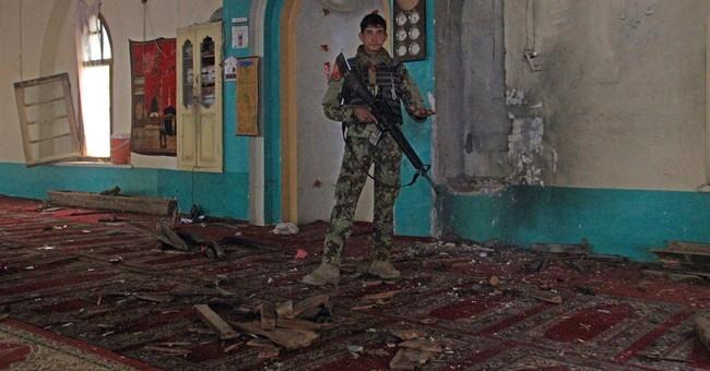 Taliban raid on guesthouse kills 2 in Afghanistan