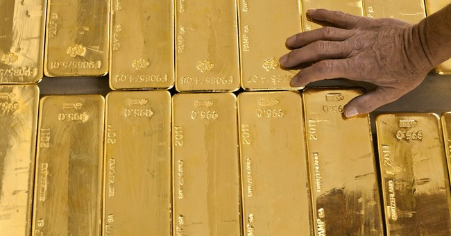 Swiss to vote on massive gold-buying plan
