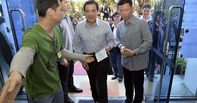 China urges Taiwan to keep ties after poll loss