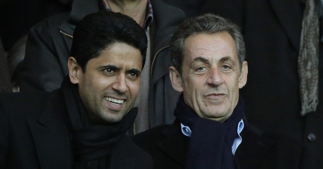 Presidency-minded Sarkozy wins party leadership