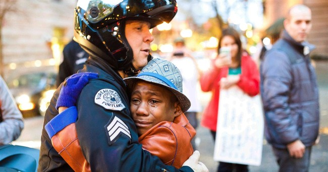 Encounter at protest leads to hug for boy, officer