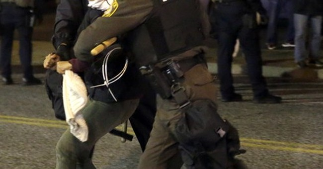 Officer who shot Michael Brown resigns in Ferguson