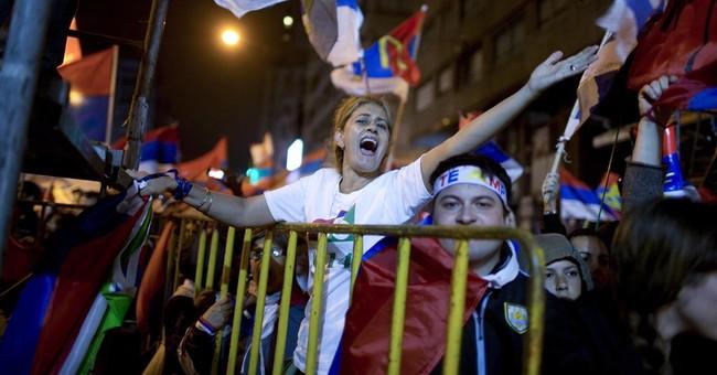 Ex-president wins Uruguay election, pot plan safe