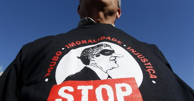 Iberia corruption, austerity fuel anger at leaders