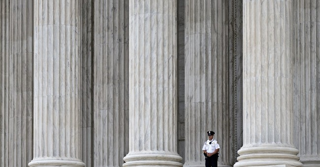 Justices weigh limits of free speech over Internet