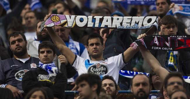 Spain soccer fan clash leaves 1 dead, 11 injured