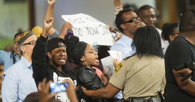 Holder announces plan to target racial profiling