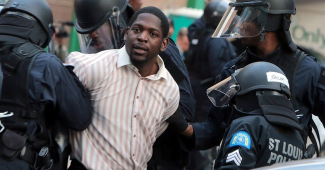 Hands-up gesture animates Ferguson protests