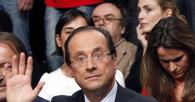 Hollande staff transferred amid gossip photo flap