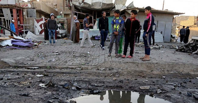 In fight against IS, Iraqi PM sacks 24 officials