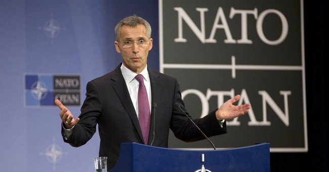 NATO steps up to Russia, but back from Afghanistan