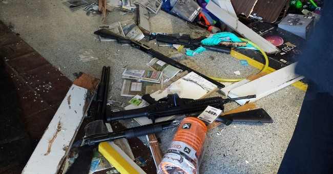 Sheriff: Man crashed car into store to steal guns
