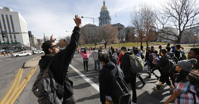Police hit by car while working Ferguson protest