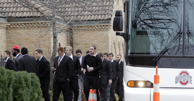 Mourners gather for Ohio St athlete's funeral