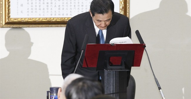 Taiwan leader quits as party chair after poll loss