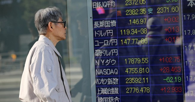 Wall Street, strong dollar push Asian stocks up