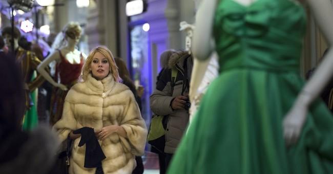 Western sanctions, ruble crash hit Russians hard