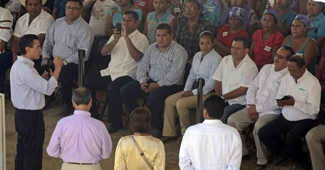 Mexican president visits state of missing students