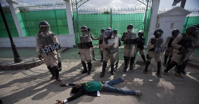 Anti-government protesters clash with Haiti police