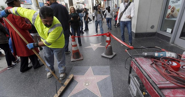 Crew removes graffiti on Cosby's Hollywood star