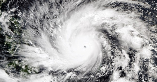 500,000 Filipinos evacuated as storm's path widens