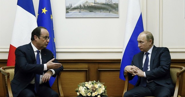 French leader reaches out to Putin in Moscow