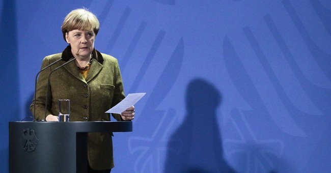 Germany's Merkel presses France, Italy on economy