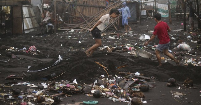 Storm exits, sparing Philippines of huge losses