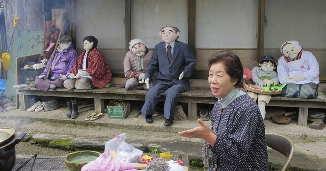 Scarecrows outnumber people in dying Japan town