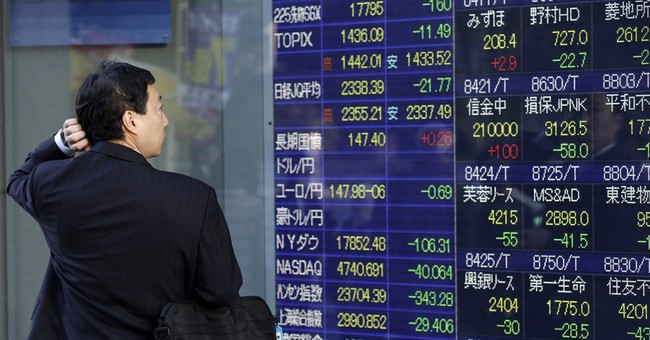 Asian shares mostly lower on weak China data